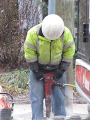 Jack Hammer Pete working on the street. (kennethkonica) Tags: usa yellow america work canon outdoors construction midwest candid indianapolis helmet working streetphotography indy indiana robins noise jackhammer hoosiers vibration canonpowershot sx50hs