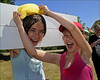 100710.048. Wet Sponge.  (THDS100710northdown-5.) (actionsnaps) Tags: girls friends water smiling laughing children kent sunny squeeze stocks familyfun captive fundraising margate enjoyment wethair playmates baseballcap thanet restrained charityevent summerfair pillory wetsponges northdownprimaryschool tenterdenway