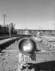 [Signal Light 3501, Track Maintenance, Texas & Pacific Railway Company] (SMU Central University Libraries) Tags: men trains tp railroads railroadtracks railroadsignals railroademployees texaspacificrailway railroadyards texasandpacific railroadmaintenance railroadswitches