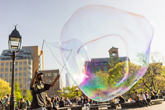 Bubbles in Washington Square Park (laskaproject) Tags: park street city nyc travel portrait people urban sun sunlight ny newyork face architecture backlight outdoors spring rainbow colorful washingtonsquarepark streetphotography bubbles soapbubbles
