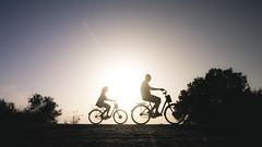 (Massimo Accarino) Tags: pictures street light sea summer urban sun white black color bicycle silhouette lumix photography running scene panasonic explore streetphoto tones gx1
