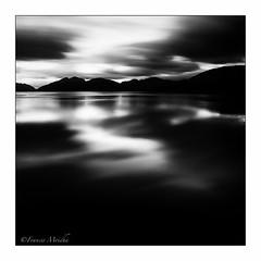 Loch Linnhe (Francis Mridha) Tags: uk longexposure travel autumn water monochrome sunrise reflections landscape scotland blackwhite movement nikon dramatic loch lochlinnhe