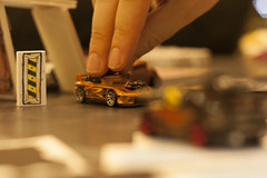 I have cleverly used my camera to make this giant's hand look normal sized (Brendan Adkins) Tags: 50mm lenstagged games dorks hotwheels canon50f18 matchbox modelcars blacktop carwars canonef50mmf18ii gpnw