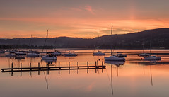 Stunning Sunrise Over Coniston Water, Lake District (MelvinNicholsonPhotography) Tags: coniston lakedistrict cumbria sunrise conistonwater canon5ds landscapephotography water reflections golder red orange amazing peaceful calm calming boats pier clouds sky fells hills