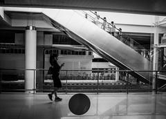 That girl . . . (okky_prisandi) Tags: 23mm grayscale film women girls texting escalator people dailyactivity airport balikpapan eastborneo kalimantanitmur indonesia sultanajimuhammadsepinggan