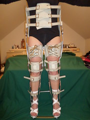 Held Erect She Balances on Her Heels in the Braces (KAFOmaker) Tags: sexy leather fetish back chains bars braces sandals leg chain strap heels heel cuff ankle buckle brace straps sandal cuffs buckles chained restraints immobile bracing restraint orthopedics restrain orthopedic cuffed strapped heeled buckling braced strapping buckled immobilize meatl