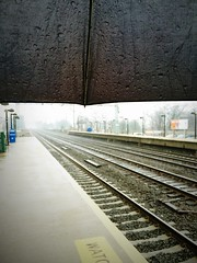 The lonely anticipation of track 3 | 18/365 | 46. Umbrella(s) or Parasol(s) (LookingUpPhotography) Tags: nyc newyorkcity apple rain train umbrella tracks lonely 365 anticipation bigapple 46 52 metronorth project365 4652 18365 oldgreenwichtrainstation