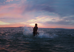(Bairon Rivera) Tags: boy sunset wet water birds clouds canon 50mm waters ripples concept 12 splash conceptual 5dmkii