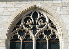 """False """"tracery"""" (actually a stone sculpture), the chapel window on the west facade, the palace of Jacques Coeur (c.1450), Bourges, Cher, France (Spencer Means) Tags: fleurdelis fleurdelys king charlesvii heart sculpture stone carving stonework window tracery false jacquescoeur palace palais house maison bourges cher france spencermeans hunkypunk dwwg"""