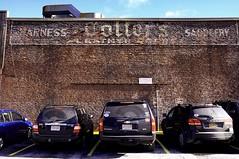 obsolete (t55z) Tags: brick cars sign parkinglot massachusetts worcester ghostsign saddlery