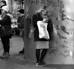 Spire (Owen J Fitzpatrick) Tags: street city ireland people bw dublin woman white black monochrome beautiful beauty fashion mobile metal lady female digital scarf hair bag photography nikon shoes waiting long pattern technology phone pavement candid telephone tiger text landmark fair skirt device surfing eire sneakers nike spire plastic needle blonde use attractive online wait dslr streaked unposed tamron tablet handbag leaning communications mane oconnell chasing lean texting fashionable 2014 welldressed superzoom republicofireland thoroughfare ojf d3200 18270mm owenjfitzpatrick ojfitzpatrick