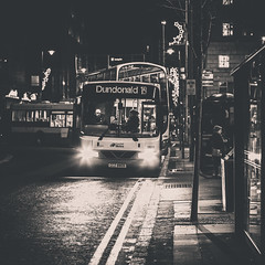 The Road Home (ColinParte) Tags: nightphotography urban bus night mono belfast gritty busstop nightlife metrolink dundonald