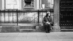 I Sit Alone (Howie Mudge LRPS) Tags: street door uk travel urban woman travelling window hat wall wales female fence relax outside outdoors person sitting serious pavement cymru steps bangor streetphotography streetlife panasonic sit resting relaxation isolated redfilter gwynedd urbanphotography northwales m43 mft micro43 microfourthirds mirrorlesscamera compactsystemcamera lumixgvario1442f3556ii micro43mountlenses panasonicdmcgx8 169perspective
