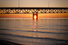 Last night was beautiful (Stella_Kar) Tags: bridge light sunset sunlight lake yellow reflections ship destination upnorth impressive mackinacbridge warmcolors sunsetcolors mackinawcity northermichigan puremichigan