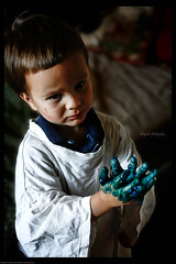 Snorri and the Gloves of Paint (Sigrun Saemundsdottir) Tags: blue boy portrait playing art boys smile childhood kids youth children fun happy kid hands paint child play hand finger painted snapshot fingers young craft casual fingerpainting fingerpaint littleartist informalportrait sigrunsaemundsdottirphotography