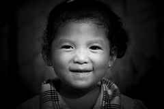Smile from Cambodia (fredMin) Tags: travel portrait people white black monochrome smile children kid cambodia fuji fujifilm kampot xt1