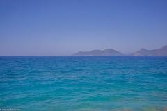 Sea view at the day (aleksey_kondratiev) Tags: turkey fethiye oludeniz mediterranean sea water blue wave waves seashore rocks sky mountain