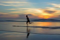 JaxBch_3402 (luv_blu_ridge) Tags: sunrise dawn skimming teens beach jacksonville panning pan nd
