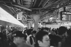 Busy (JanneM) Tags: bw film station japan 35mm canon kiss jan crowd platform delta   osaka 100 kansai ilford platser janne  objekt moren mnniskor importerataggar