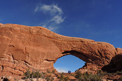 Grand - Scale Difference (Drriss & Marrionn) Tags: travel red sky people cliff usa cloud mountain mountains nature rock clouds landscape utah sandstone skies arch outdoor roadtrip canyon moab blueskies mountainside archesnationalpark lasal rockformation crag northwindow naturalarch