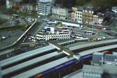 Mini Express (| Voiceb[ ]x Photography |) Tags: tiltshift adamvoice sonya6000 ilce6000 train bus boat transport portsmouth mini small effect blur city spinnaker spinnakertower 70s architecture architect nationalexpress high multiple water