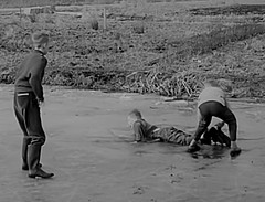 1962 Do you help a friend (theirhistory) Tags: boy child kid river bank canal holland netherlands jumper shirt wet wellies shoes rubberboots ice melting
