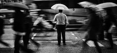 When people run in circles (. Jianwei .) Tags: street urban rain vancouver umbrella mood sony slowshutter 2014 nex madworld kemily