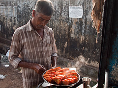 Malabari fastfood (Evgeni Zotov) Tags: street city red people food india man hot pepper fastfood cook kerala steam indie spicy mussel indi indien inde malabar  hindistan   ndia kannur   cannanore