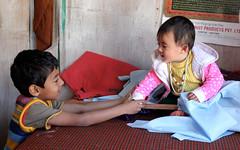 Tender moment (Nagarjun) Tags: family bhutan malu tatu nag kanishka kinu malathi nagarjun takshila
