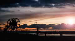 Bremerhaven - Mole (Lumins) Tags: light sky panorama lighthouse colors clouds germany shine sundown pano sony alpha bremerhaven