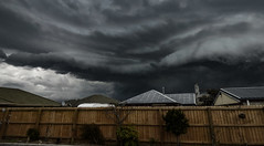 The Forecast is Rain (Steve Taylor (Photography)) Tags: roof newzealand christchurch sky cloud house cold rain fence garden grey spring stormy eerie canterbury nz southisland northnewbrighton