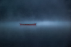 The Red Canoe (jeanmarie shelton) Tags: morning light red sunlight mist lake nature water fog sunrise reflections dark landscape nikon shadows minimal canoe serene minimalism minimalistic jeanmarie innamoramento jeanmarieshelton