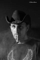 ritratto (sanino fabrizio) Tags: portrait canon monocromo bn western 1855 bianco ritratto nero cappello fumo sigaro texano 550d smooke
