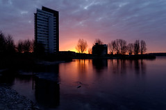 Morning in Almere (JaapFoto) Tags: morning trees water skyline clouds sunrise d70 outdoor dusk flevoland appartmentbuilding almere morningsun weerwater almerestad filmwijk