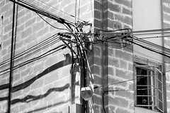Electricity (petia.balabanova) Tags: city travel blackandwhite monochrome lines lights monocromo shadows malta cables electricity 2470mm nikond800