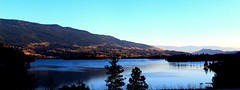 A shot from the car while driving by Kalamalka Lake (jok33) Tags: lake mountains canada kelownabc kalamalmalake sunset warmth landscape