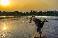 Beat the Heat (Shazim Butt) Tags: water beat heat sunset trees river ravi jump shazim butt sky sun reflection light golden photography splash lahore pakistan