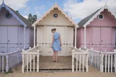 another day, another beach hut... (Sarah-Louise Burns) Tags: mersea westmersea merseaisland beach beachhut hut huts vintage retro summer sunny sunshine pretty girl blue dress blonde hair