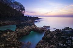 Padang Bai (Goesena) Tags: longexposure travel blue bali cloud sun tree water yellow rock sunrise landscape nikon tokina homemade 116 seas gnd nd1000 d7000