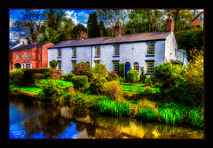 Pond Cottages (A Digital Artist) Tags: england reflection building water beautiful architecture clouds landscape pond village waterfront cheshire northwest serene tranquil scenics lymm canon1855mm kevinwalker canon1100d