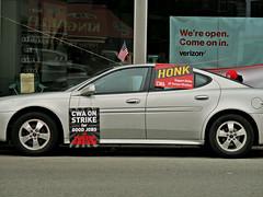 Honk Support Strike (Robert S. Photography) Tags: nyc reflection window sign shop brooklyn canon may powershot strike striking honk verizon 2016 iso160 elph160