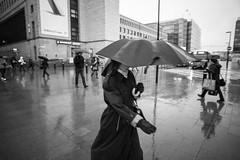 Umbrella series (HKI DRFTR) Tags: life urban blackandwhite rain lady umbrella finland helsinki candid coat streetphotography decisivemoment rainyweather streetscenery