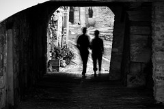 into the light (alexhaeusler) Tags: street light people silhouette blackwhite couple tunnel