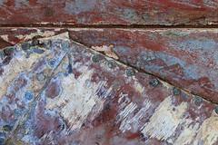 Macro Texture Study 3 (katie47n) Tags: macro boat hull peelingpaint rust texture detail abstract wood old wickford ri color weathered worn shipyard boatyard
