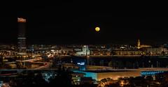 Super Luna sobre Sevilla... (protsalke) Tags: city longexposure urban moon tower architecture night lights sevilla cityscape nightscape cathedral nocturna supermoon