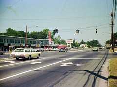 The Boston Post Road looking west from the the very edge of the Connecticut Post Shopping Center parking lot. 1960s and 1970s cars, American Carpet Stores, Dunkin Donuts and a Mobil station. Milford Connecticut. July 1974 (wavz13) Tags: vintagecar grain americana oldphotographs grainy oldcar oldphotos oldcars vintagecars kodacolor instamatic vintagephotos oldsigns oldphotography vintagesigns vintagephotographs 110film oldstores vintagechevy oldfords vintagephotography collectablecars vintagestores collectiblecars 1970sphotos vintagestoresigns connecticutphotography vintageamericana 1970scars 1960scar oldchevys connecticutphotos oldcadillacs vintagefords oldhighways 1970sphotographs vintageconnecticut 1970sphotography oldpontiacs oldconnecticut oldmilford vintagecadillacs vintagepontiacs oldstoresigns vintagehighways connecticutphotographs oldconnecticutphotography oldconnecticutphotos vintagewoodmont oldwoodmont vintagemilford 1970swoodmont 1970smilford oldchevystationwagons oldchevroletstationwagons vintagechevystationwagons vintagechevroletstationwagons vintagedunkindonutssigns olddunkindonutssigns oldmobilesigns vintagemobilsigns