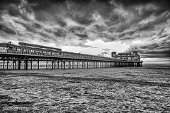 The End of the Pier (Explored) (Alex Chilli) Tags: sunset blackandwhite beach monochrome clouds bristol evening coast pier seaside sand fuji empty structure xa2 solo deserted weston grandpier expanse supermare explored inexplore