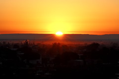 Amanecer Riojano (JRZ-90) Tags: old city travel winter sunset red sun white house mountain tourism argentina beautiful fog town cityscape village view sundown smoke sunny picturesque backlighting yallow larioja