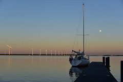 The moon is friend for the lonesome to talk to. (Pics4life.nl off and on next week) Tags: blue light sky moon water windmill colors evening boat ship flag luna serene lucht maan windmolens maanlicht sereen