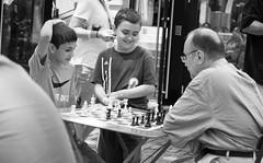 The Generation Gap (John Bense) Tags: street city people urban blackandwhite game monochrome children fun child play adult board grandfather chess parent boardgame generation grandparent